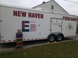 Lily donated 26 boxes of Girl Scout cookies to the New Haven Food Bank.